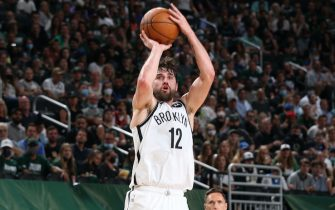 MILWAUKEE, WI - JUNE 10: Joe Harris #12 of the Brooklyn Nets shoots the ball during the game against the Milwaukee Bucks during Round 2, Game 3 of the 2021 NBA Playoffs on June 10, 2021 at the Fiserv Forum Center in Milwaukee, Wisconsin. NOTE TO USER: User expressly acknowledges and agrees that, by downloading and or using this Photograph, user is consenting to the terms and conditions of the Getty Images License Agreement. Mandatory Copyright Notice: Copyright 2021 NBAE (Photo by Gary Dineen/NBAE via Getty Images).