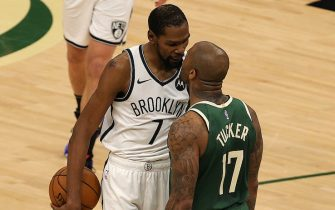 MILWAUKEE, WISCONSIN - JUNE 10: Kevin Durant #7 of the Brooklyn Nets and P.J. Tucker #17 of the Milwaukee Bucks exchange words during the second half of Game Three of the Eastern Conference second round playoff series at the Fiserv Forum on June 10, 2021 in Milwaukee, Wisconsin. NOTE TO USER: User expressly acknowledges and agrees that, by downloading and or using this photograph, User is consenting to the terms and conditions of the Getty Images License Agreement. (Photo by Stacy Revere/Getty Images)
