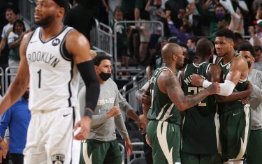 MILWAUKEE, WI - JUNE 10: The Milwaukee Bucks celebrate after winning Round 2, Game 3 of the 2021 NBA Playoffs against the Brooklyn Nets on June 10, 2021 at the Fiserv Forum Center in Milwaukee, Wisconsin. NOTE TO USER: User expressly acknowledges and agrees that, by downloading and or using this Photograph, user is consenting to the terms and conditions of the Getty Images License Agreement. Mandatory Copyright Notice: Copyright 2021 NBAE (Photo by Gary Dineen/NBAE via Getty Images).