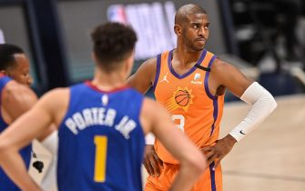 DENVER, CO - JUNE 11:  Chris Paul #3 of the Phoenix Suns looks on in the first half of Game Three of the Western Conference second-round playoff series at Ball Arena on June 11, 2021 in Denver, Colorado. NOTE TO USER: User expressly acknowledges and agrees that, by downloading and or using this photograph, User is consenting to the terms and conditions of the Getty Images License Agreement. (Photo by Dustin Bradford/Getty Images)
