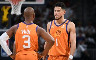 DENVER, CO - JUNE 11: Chris Paul #3 and Devin Booker #1 of the Phoenix Suns talk during Round 2, Game 3 of the 2021 NBA Playoffs on June 11, 2021 at the Ball Arena in Denver, Colorado. NOTE TO USER: User expressly acknowledges and agrees that, by downloading and/or using this Photograph, user is consenting to the terms and conditions of the Getty Images License Agreement. Mandatory Copyright Notice: Copyright 2021 NBAE (Photo by Garrett Ellwood/NBAE via Getty Images)