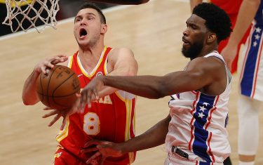 ATLANTA, GEORGIA - JUNE 11:  Joel Embiid #21 of the Philadelphia 76ers strips the ball from Danilo Gallinari #8 of the Atlanta Hawks during the second half of game 3 of the Eastern Conference Semifinals at State Farm Arena on June 11, 2021 in Atlanta, Georgia.  NOTE TO USER: User expressly acknowledges and agrees that, by downloading and or using this photograph, User is consenting to the terms and conditions of the Getty Images License Agreement. (Photo by Kevin C. Cox/Getty Images)