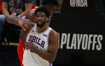 ATLANTA, GEORGIA - JUNE 11:  Joel Embiid #21 of the Philadelphia 76ers reacts after drawing a foul from John Collins #20 of the Atlanta Hawks during the second half of game 3 of the Eastern Conference Semifinals at State Farm Arena on June 11, 2021 in Atlanta, Georgia.  NOTE TO USER: User expressly acknowledges and agrees that, by downloading and or using this photograph, User is consenting to the terms and conditions of the Getty Images License Agreement. (Photo by Kevin C. Cox/Getty Images)