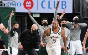 MILWAUKEE, WI - JUNE 13: P.J. Tucker #17 of the Milwaukee Bucks reacts to his three point basket during the game against the Brooklyn Nets during Round 2, Game 4 of the 2021 NBA Playoffs  on June 13, 2021 at the Fiserv Forum Center in Milwaukee, Wisconsin. NOTE TO USER: User expressly acknowledges and agrees that, by downloading and or using this Photograph, user is consenting to the terms and conditions of the Getty Images License Agreement. Mandatory Copyright Notice: Copyright 2021 NBAE (Photo by Gary Dineen/NBAE via Getty Images).
