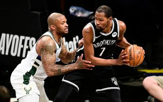 NEW YORK, NEW YORK - JUNE 05:  Kevin Durant #7 of the Brooklyn Nets is defended by P.J. Tucker #17 of the Milwaukee Bucks in Game One of the Second Round of the 2021 NBA Playoffs at Barclays Center on June 05, 2021 in New York City. NOTE TO USER: User expressly acknowledges and agrees that, by downloading and or using this photograph, User is consenting to the terms and conditions of the Getty Images License Agreement. (Photo by Steven Ryan/Getty Images)