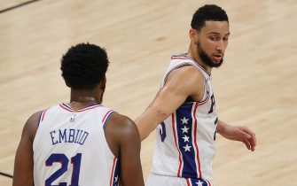 ATLANTA, GEORGIA - JUNE 14:  Ben Simmons #25 of the Philadelphia 76ers reacts towards Joel Embiid #21 during the second half of game 4 of the Eastern Conference Semifinals against the Atlanta Hawks at State Farm Arena on June 14, 2021 in Atlanta, Georgia.  NOTE TO USER: User expressly acknowledges and agrees that, by downloading and or using this photograph, User is consenting to the terms and conditions of the Getty Images License Agreement. (Photo by Kevin C. Cox/Getty Images)