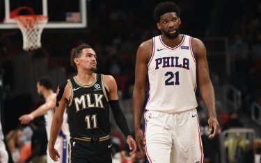 ATLANTA, GA - JUNE 14: Trae Young #11 of the Atlanta Hawks and Joel Embiid #21 of the Philadelphia 76ers talk  during Round 2, Game 4 of the Eastern Conference Playoffs on June 14, 2021 at State Farm Arena in Atlanta, Georgia. NOTE TO USER: User expressly acknowledges and agrees that, by downloading and/or using this Photograph, user is consenting to the terms and conditions of the Getty Images License Agreement. Mandatory Copyright Notice: Copyright 2021 NBAE (Photo by David Dow/NBAE via Getty Images)