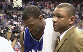 AUBURN HILLS, MI - MAY 4:  Tracy McGrady #1 and head coach Doc Rivers of the Orlando Magic stoically walk off the floor after the loss in Game seven against the Detroit Pistons in the Eastern Conference Quaterfinals during the 2003 NBA Playoffs at The Palace of Auburn Hills on May 4, 2003  in Auburn Hills, Michigan.  The Pistons won 108-93.  NOTE TO USER: User expressly acknowledges and agrees that, by downloading and or using this photograph, User is consenting to the terms and conditions of the Getty Images License Agreement. (Photo by Allen Einstein/NBAE via Getty Images)