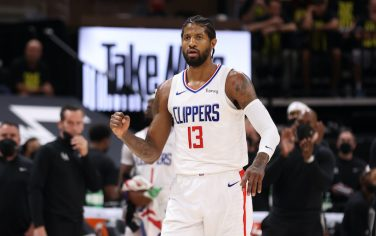 SALT LAKE CITY, UT - JUNE 16: Paul George #13 of the LA Clippers celebrates against the Utah Jazz  during Round 2, Game 5 of the 2021 NBA Playoffs on June 16 1, 2021 at vivint.SmartHome Arena in Salt Lake City, Utah. NOTE TO USER: User expressly acknowledges and agrees that, by downloading and or using this Photograph, User is consenting to the terms and conditions of the Getty Images License Agreement. Mandatory Copyright Notice: Copyright 2021 NBAE (Photo by David Sherman/NBAE via Getty Images)