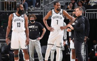 MILWAUKEE, WI - JUNE 17: Head Coach Steve Nash of the Brooklyn Nets talks to James Harden #13 of the Brooklyn Nets and Kevin Durant #7 of the Brooklyn Nets during the game against the Milwaukee Bucks during Round 2, Game 6 of the 2021 NBA Playoffs on June 17, 2021 at the Fiserv Forum Center in Milwaukee, Wisconsin. NOTE TO USER: User expressly acknowledges and agrees that, by downloading and or using this Photograph, user is consenting to the terms and conditions of the Getty Images License Agreement. Mandatory Copyright Notice: Copyright 2021 NBAE (Photo by Nathaniel S. Butler/NBAE via Getty Images).