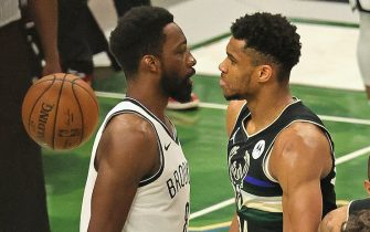 MILWAUKEE, WISCONSIN - JUNE 17: Giannis Antetokounmpo #34 of the Milwaukee Bucks stares down Jeff Green #8 of the Brooklyn Nets after dunking on him at Fiserv Forum on June 17, 2021 in Milwaukee, Wisconsin. The Bucks defeated the Nets 104-89. NOTE TO USER: User expressly acknowledges and agrees that, by downloading and or using this photograph, User is consenting to the terms and conditions of the Getty Images License Agreement.  (Photo by Jonathan Daniel/Getty Images)