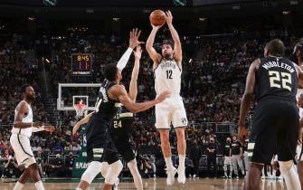MILWAUKEE, WI - JUNE 17: Joe Harris #12 of the Brooklyn Nets shoots the ball during the game against the Milwaukee Bucks during Round 2, Game 6 of the 2021 NBA Playoffs on June 17, 2021 at the Fiserv Forum Center in Milwaukee, Wisconsin. NOTE TO USER: User expressly acknowledges and agrees that, by downloading and or using this Photograph, user is consenting to the terms and conditions of the Getty Images License Agreement. Mandatory Copyright Notice: Copyright 2021 NBAE (Photo by Nathaniel S. Butler/NBAE via Getty Images).