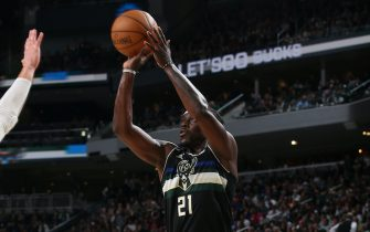 MILWAUKEE, WI - JUNE 17: Jrue Holiday #21 of the Milwaukee Bucks shoots a three point basket against the Brooklyn Nets during Round 2, Game 6 of the 2021 NBA Playoffs on June 17, 2021 at the Fiserv Forum Center in Milwaukee, Wisconsin. NOTE TO USER: User expressly acknowledges and agrees that, by downloading and or using this Photograph, user is consenting to the terms and conditions of the Getty Images License Agreement. Mandatory Copyright Notice: Copyright 2021 NBAE (Photo by Gary Dineen/NBAE via Getty Images).