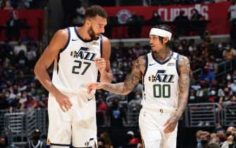 LOS ANGELES, CA - JUNE 12: Rudy Gobert #27 talks with Jordan Clarkson #00 of the Utah Jazz during Round 2, Game 3 of the 2021 NBA Playoffs on June 12, 2021 at STAPLES Center in Los Angeles, California. NOTE TO USER: User expressly acknowledges and agrees that, by downloading and/or using this Photograph, user is consenting to the terms and conditions of the Getty Images License Agreement. Mandatory Copyright Notice: Copyright 2021 NBAE (Photo by Adam Pantozzi/NBAE via Getty Images)
