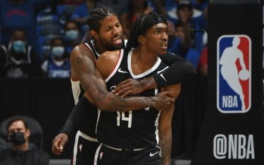 LOS ANGELES, CA - JUNE 18: Paul George #13 and Terance Mann #14 of the LA Clippers celebrate during the game against the Utah Jazz during Round 2, Game 6 of the 2021 NBA Playoffs on June 18, 2021 at STAPLES Center in Los Angeles, California. NOTE TO USER: User expressly acknowledges and agrees that, by downloading and/or using this Photograph, user is consenting to the terms and conditions of the Getty Images License Agreement. Mandatory Copyright Notice: Copyright 2021 NBAE (Photo by Andrew D. Bernstein/NBAE via Getty Images)