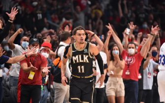 ATLANTA, GA - JUNE 18: Trae Young #11 of the Atlanta Hawks reacts during a game against the Philadelphia 76ers during Round 2, Game 6 of the Eastern Conference Playoffs on June 18, 2021 at State Farm Arena in Atlanta, Georgia. NOTE TO USER: User expressly acknowledges and agrees that, by downloading and/or using this Photograph, user is consenting to the terms and conditions of the Getty Images License Agreement. Mandatory Copyright Notice: Copyright 2021 NBAE (Photo by Jesse D. Garrabrant/NBAE via Getty Images)