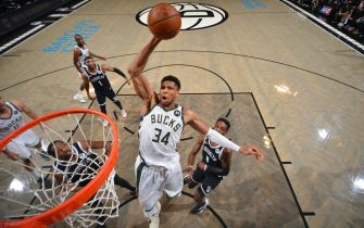 BROOKLYN, NY - JUNE 19: Giannis Antetokounmpo #34 of the Milwaukee Bucks dunks the ball against the Brooklyn Nets during Round 2, Game 7 on June 19, 2021 at Barclays Center in Brooklyn, New York. NOTE TO USER: User expressly acknowledges and agrees that, by downloading and/or using this Photograph, user is consenting to the terms and conditions of the Getty Images License Agreement. Mandatory Copyright Notice: Copyright 2021 NBAE (Photo by Jesse D. Garrabrant/NBAE via Getty Images)