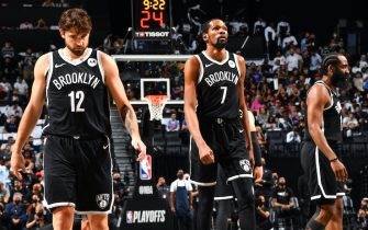 BROOKLYN, NY - JUNE 19: Joe Harris #12 of the Brooklyn Nets, Kevin Durant #7 of the Brooklyn Nets, and James Harden #13 of the Brooklyn Nets look on during Round 2, Game 7 on June 19, 2021 at Barclays Center in Brooklyn, New York. NOTE TO USER: User expressly acknowledges and agrees that, by downloading and/or using this Photograph, user is consenting to the terms and conditions of the Getty Images License Agreement. Mandatory Copyright Notice: Copyright 2021 NBAE (Photo by Jesse D. Garrabrant/NBAE via Getty Images)