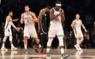 BROOKLYN, NY - JUNE 19: Jrue Holiday #21 of the Milwaukee Bucks reacts during a game against the Brooklyn Nets during Round 2, Game 7 on June 19, 2021 at Barclays Center in Brooklyn, New York. NOTE TO USER: User expressly acknowledges and agrees that, by downloading and/or using this Photograph, user is consenting to the terms and conditions of the Getty Images License Agreement. Mandatory Copyright Notice: Copyright 2021 NBAE (Photo by Jesse D. Garrabrant/NBAE via Getty Images)