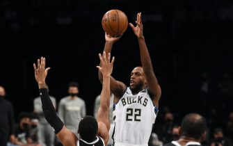 BROOKLYN, NY - JUNE 19: Khris Middleton #22 of the Milwaukee Bucks shoots a three-pointer against the Brooklyn Nets during Round 2, Game 7 on June 19, 2021 at Barclays Center in Brooklyn, New York. NOTE TO USER: User expressly acknowledges and agrees that, by downloading and/or using this Photograph, user is consenting to the terms and conditions of the Getty Images License Agreement. Mandatory Copyright Notice: Copyright 2021 NBAE (Photo by David Dow/NBAE via Getty Images)