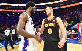 PHILADELPHIA, PA - JUNE 20: Ben Simmons #25 of the Philadelphia 76ers and Danilo Gallinari #8 of the Atlanta Hawks high-five after Round 2, Game 7 of the Eastern Conference Playoffs on June 20, 2021 at Wells Fargo Center in Philadelphia, Pennsylvania. NOTE TO USER: User expressly acknowledges and agrees that, by downloading and/or using this Photograph, user is consenting to the terms and conditions of the Getty Images License Agreement. Mandatory Copyright Notice: Copyright 2021 NBAE (Photo by Jesse D. Garrabrant/NBAE via Getty Images)