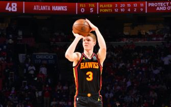 PHILADELPHIA, PA - JUNE 20: Kevin Huerter #3 of the Atlanta Hawks shoots a three-pointer against the Philadelphia 76ers during Round 2, Game 7 of the Eastern Conference Playoffs on June 20, 2021 at Wells Fargo Center in Philadelphia, Pennsylvania. NOTE TO USER: User expressly acknowledges and agrees that, by downloading and/or using this Photograph, user is consenting to the terms and conditions of the Getty Images License Agreement. Mandatory Copyright Notice: Copyright 2021 NBAE (Photo by Jesse D. Garrabrant/NBAE via Getty Images)