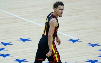 PHILADELPHIA, PENNSYLVANIA - JUNE 20: Trae Young #11 of the Atlanta Hawks celebrates during the fourth quarter against the Philadelphia 76ers during Game Seven of the Eastern Conference Semifinals at Wells Fargo Center on June 20, 2021 in Philadelphia, Pennsylvania. NOTE TO USER: User expressly acknowledges and agrees that, by downloading and or using this photograph, User is consenting to the terms and conditions of the Getty Images License Agreement. (Photo by Tim Nwachukwu/Getty Images)