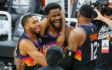 PHOENIX, ARIZONA - JUNE 22: Deandre Ayton #22 of the Phoenix Suns, Torrey Craig #12, and Mikal Bridges #25 celebrate defeating the LA Clippers 104-103 in game two of the NBA Western Conference finals at Phoenix Suns Arena on June 22, 2021 in Phoenix, Arizona. NOTE TO USER: User expressly acknowledges and agrees that, by downloading and or using this photograph, User is consenting to the terms and conditions of the Getty Images License Agreement.  (Photo by Christian Petersen/Getty Images)