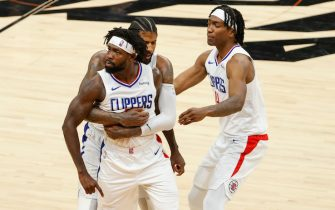 PHOENIX, ARIZONA - JUNE 22: Patrick Beverley #21, Paul George #13, and Terance Mann #14 of the LA Clippers react during the fourth quarter in game two of the NBA Western Conference finals against the Phoenix Suns at Phoenix Suns Arena on June 22, 2021 in Phoenix, Arizona. NOTE TO USER: User expressly acknowledges and agrees that, by downloading and or using this photograph, User is consenting to the terms and conditions of the Getty Images License Agreement.  (Photo by Christian Petersen/Getty Images)
