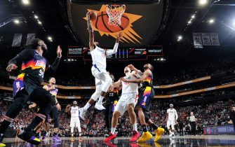 PHOENIX, AZ - JUNE 22: Paul George #13 of the LA Clippers shoots the ball during the game against the Phoenix Suns during Game 2 of the Western Conference Finals of the 2021 NBA Playoffs on June 22, 2021 at Phoenix Suns Arena in Phoenix, Arizona. NOTE TO USER: User expressly acknowledges and agrees that, by downloading and or using this photograph, user is consenting to the terms and conditions of the Getty Images License Agreement. Mandatory Copyright Notice: Copyright 2021 NBAE (Photo by Barry Gossage/NBAE via Getty Images)
