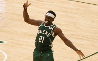 MILWAUKEE, WI - JUNE 23: Jrue Holiday #21 of the Milwaukee Bucks celebrates during the game against the Atlanta Hawks during Game 1 of the Eastern Conference Finals of the 2021 NBA Playoffs on June 23, 2021 at the Fiserv Forum Center in Milwaukee, Wisconsin. NOTE TO USER: User expressly acknowledges and agrees that, by downloading and or using this Photograph, user is consenting to the terms and conditions of the Getty Images License Agreement. Mandatory Copyright Notice: Copyright 2021 NBAE (Photo by Kamil Krzaczynski/NBAE via Getty Images).