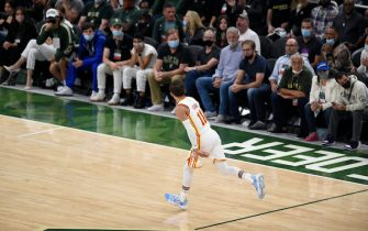 MILWAUKEE, WISCONSIN - JUNE 23: Trae Young #11 of the Atlanta Hawks celebrates a basket against the Milwaukee Bucks during the second quarter in game one of the Eastern Conference Finals at Fiserv Forum on June 23, 2021 in Milwaukee, Wisconsin. (Photo by Patrick McDermott/Getty Images)