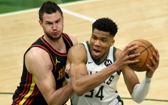 MILWAUKEE, WISCONSIN - JUNE 25: Giannis Antetokounmpo #34 of the Milwaukee Bucks is pressured by Danilo Gallinari #8 of the Atlanta Hawks during the first half in game two of the Eastern Conference Finals at Fiserv Forum on June 25, 2021 in Milwaukee, Wisconsin. NOTE TO USER: User expressly acknowledges and agrees that, by downloading and or using this photograph, User is consenting to the terms and conditions of the Getty Images License Agreement. (Photo by Patrick McDermott/Getty Images)