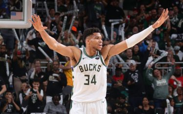 MILWAUKEE, WI - JUNE 25: Giannis Antetokounmpo #34 of the Milwaukee Bucks puts his hands up during the game against the Atlanta Hawks during Game 1 of the Eastern Conference Finals of the 2021 NBA Playoffs on June 25, 2021 at the Fiserv Forum Center in Milwaukee, Wisconsin. NOTE TO USER: User expressly acknowledges and agrees that, by downloading and or using this Photograph, user is consenting to the terms and conditions of the Getty Images License Agreement. Mandatory Copyright Notice: Copyright 2021 NBAE (Photo by Nathaniel S. Butler/NBAE via Getty Images).