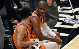 LOS ANGELES, CALIFORNIA - JUNE 26: Chris Paul #3 and Devin Booker #1 of the Phoenix Suns talk on the bench during a time out against the LA Clippers during the first half in game four of the Western Conference Finals at Staples Center on June 26, 2021 in Los Angeles, California. NOTE TO USER: User expressly acknowledges and agrees that, by downloading and or using this photograph, User is consenting to the terms and conditions of the Getty Images License  (Photo by Kevork Djansezian/Getty Images)