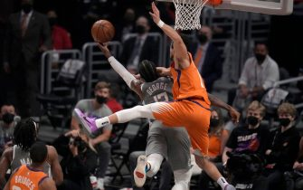 Los Angeles, CA - June 26:  Paul George #13 of the LA Clippers is fouled by Devin Booker #1 of the Phoenix Suns in the first half of game four of a Western Conference finals NBA playoff basketball game at the Staples Center in Los Angeles on Saturday, June 26, 2021. (Photo by Keith Birmingham/MediaNews Group/Pasadena Star-News via Getty Images)