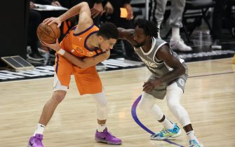 LOS ANGELES, CALIFORNIA - JUNE 26: Devin Booker #1 of the Phoenix Suns drives against Patrick Beverley #21 of the LA Clippers during the second half in game four of the Western Conference Finals at Staples Center on June 26, 2021 in Los Angeles, California. NOTE TO USER: User expressly acknowledges and agrees that, by downloading and or using this photograph, User is consenting to the terms and conditions of the Getty Images License  (Photo by Ronald Martinez/Getty Images)