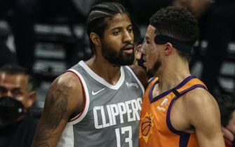 Saturday, June 26, 2021, Los Angeles CA  - LA Clippers guard Paul George (13) faces off with Phoenix Suns guard Devin Booker (1) after a foul in Game four of the NBA Western Conference Finals at Staples Center.  (Robert Gauthier/Los Angeles Times via Getty Images)