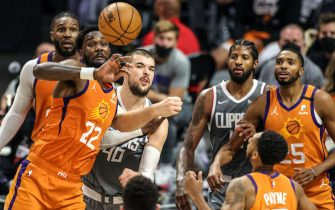 Saturday, June 26, 2021, Los Angeles CA  - Phoenix Suns center Deandre Ayton (22) looks to control a rebound  during first half action in Game four of the NBA Western Conference Finals at Staples Center.  (Robert Gauthier/Los Angeles Times via Getty Images)
