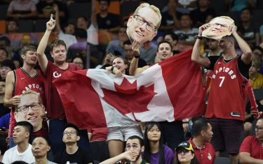 Canadian fans hold their national flag along with the portraits of team's coach Nick Nurse during the Basketball World Cup Group H game between Canada and Australia in Dongguan on September 1, 2019. (Photo by Ye Aung Thu / AFP)        (Photo credit should read YE AUNG THU/AFP via Getty Images)
