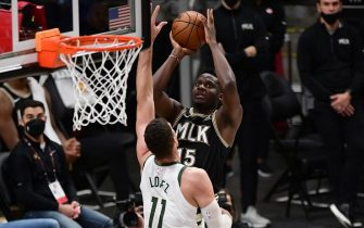 ATLANTA, GA - JuNE 29: Clint Capela #15 of the Atlanta Hawks shoots the ball against the Milwaukee Bucks during Game 4 of the Eastern Conference Finals of the 2021 NBA Playoffs on June 29, 2021 at State Farm Arena in Atlanta, Georgia.  NOTE TO USER: User expressly acknowledges and agrees that, by downloading and/or using this Photograph, user is consenting to the terms and conditions of the Getty Images License Agreement. Mandatory Copyright Notice: Copyright 2021 NBAE (Photo by Adam Hagy/NBAE via Getty Images)