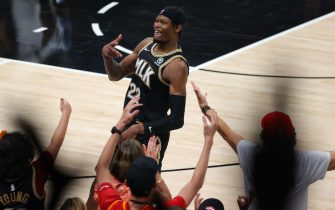 ATLANTA, GEORGIA - JUNE 29: Cam Reddish #22 of the Atlanta Hawks celebrates a three point basket against the Milwaukee Bucks during the second half in Game Four of the Eastern Conference Finals at State Farm Arena on June 29, 2021 in Atlanta, Georgia. NOTE TO USER: User expressly acknowledges and agrees that, by downloading and or using this photograph, User is consenting to the terms and conditions of the Getty Images License Agreement. (Photo by Kevin C. Cox/Getty Images)