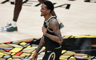 ATLANTA, GA - JuNE 29: Lou Williams #6 of the Atlanta Hawks smiles during Game 4 of the Eastern Conference Finals of the 2021 NBA Playoffs on June 29, 2021 at State Farm Arena in Atlanta, Georgia.  NOTE TO USER: User expressly acknowledges and agrees that, by downloading and/or using this Photograph, user is consenting to the terms and conditions of the Getty Images License Agreement. Mandatory Copyright Notice: Copyright 2021 NBAE (Photo by Adam Hagy/NBAE via Getty Images)