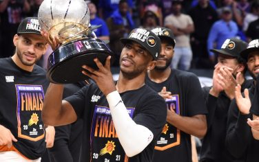LOS ANGELES, CA - JUNE 30: Chris Paul #3 of the Phoenix Suns holds the Western Conference Finals trophy after Game 6 of the Western Conference Finals of the 2021 NBA Playoffs on June 30, 2021 at STAPLES Center in Los Angeles, California. NOTE TO USER: User expressly acknowledges and agrees that, by downloading and/or using this Photograph, user is consenting to the terms and conditions of the Getty Images License Agreement. Mandatory Copyright Notice: Copyright 2021 NBAE (Photo by Andrew D. Bernstein/NBAE via Getty Images)