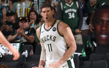 MILWAUKEE, WI - JULY 1: Brook Lopez #11 of the Milwaukee Bucks celebrates during Game 5 of the Eastern Conference Finals of the 2021 NBA Playoffs on July 1, 2021 at the Fiserv Forum Center in Milwaukee, Wisconsin. NOTE TO USER: User expressly acknowledges and agrees that, by downloading and or using this Photograph, user is consenting to the terms and conditions of the Getty Images License Agreement. Mandatory Copyright Notice: Copyright 2021 NBAE (Photo by Gary Dineen/NBAE via Getty Images).