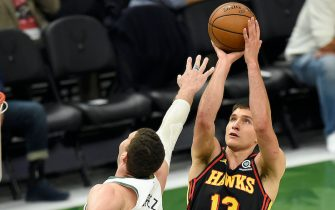 MILWAUKEE, WISCONSIN - JULY 01: Bogdan Bogdanovic #13 of the Atlanta Hawks shoots against Brook Lopez #11 of the Milwaukee Bucks during the first half in Game Five of the Eastern Conference Finals at Fiserv Forum on July 01, 2021 in Milwaukee, Wisconsin. NOTE TO USER: User expressly acknowledges and agrees that, by downloading and or using this photograph, User is consenting to the terms and conditions of the Getty Images License Agreement. (Photo by Patrick McDermott/Getty Images)