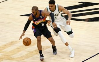 PHOENIX, ARIZONA - FEBRUARY 10: Chris Paul #3 of the Phoenix Suns handle the ball against Giannis Antetokounmpo #34 of the Milwaukee Bucks during the second half of the NBA game at Phoenix Suns Arena on February 10, 2021 in Phoenix, Arizona.   The Suns defeated the Bucks 125-124. NOTE TO USER: User expressly acknowledges and agrees that, by downloading and or using this photograph, User is consenting to the terms and conditions of the Getty Images License Agreement. (Photo by Christian Petersen/Getty Images)