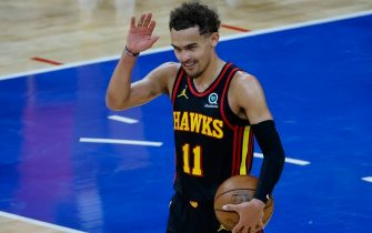 PHILADELPHIA, PENNSYLVANIA - JUNE 20: Trae Young #11 of the Atlanta Hawks celebrates after defeating the Philadelphia 76ers during Game Seven of the Eastern Conference Semifinals at Wells Fargo Center on June 20, 2021 in Philadelphia, Pennsylvania. NOTE TO USER: User expressly acknowledges and agrees that, by downloading and or using this photograph, User is consenting to the terms and conditions of the Getty Images License Agreement. (Photo by Tim Nwachukwu/Getty Images)