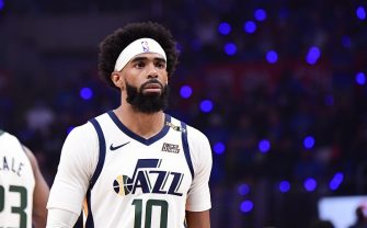LOS ANGELES, CA - JUNE 18: Mike Conley #10 of the Utah Jazz looks on before the game against the LA Clippers during Round 2, Game 6 of the 2021 NBA Playoffs on June 18, 2021 at STAPLES Center in Los Angeles, California. NOTE TO USER: User expressly acknowledges and agrees that, by downloading and/or using this Photograph, user is consenting to the terms and conditions of the Getty Images License Agreement. Mandatory Copyright Notice: Copyright 2021 NBAE (Photo by Adam Pantozzi/NBAE via Getty Images)