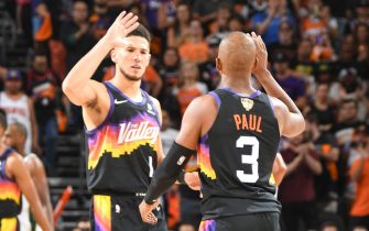 PHOENIX, AZ - JULY 6: Devin Booker #1 of the Phoenix Suns high fives Chris Paul #3 of the Phoenix Suns during the game against the Milwaukee Bucks during Game One of the 2021 NBA Finals on July 6, 2021 at Phoenix Suns Arena in Phoenix, Arizona. NOTE TO USER: User expressly acknowledges and agrees that, by downloading and or using this photograph, user is consenting to the terms and conditions of the Getty Images License Agreement. Mandatory Copyright Notice: Copyright 2021 NBAE (Photo by Andrew D. Bernstein/NBAE via Getty Images)